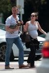 A very pregnant Ashley Hebert with husband J.P Rosenbaum in Miami