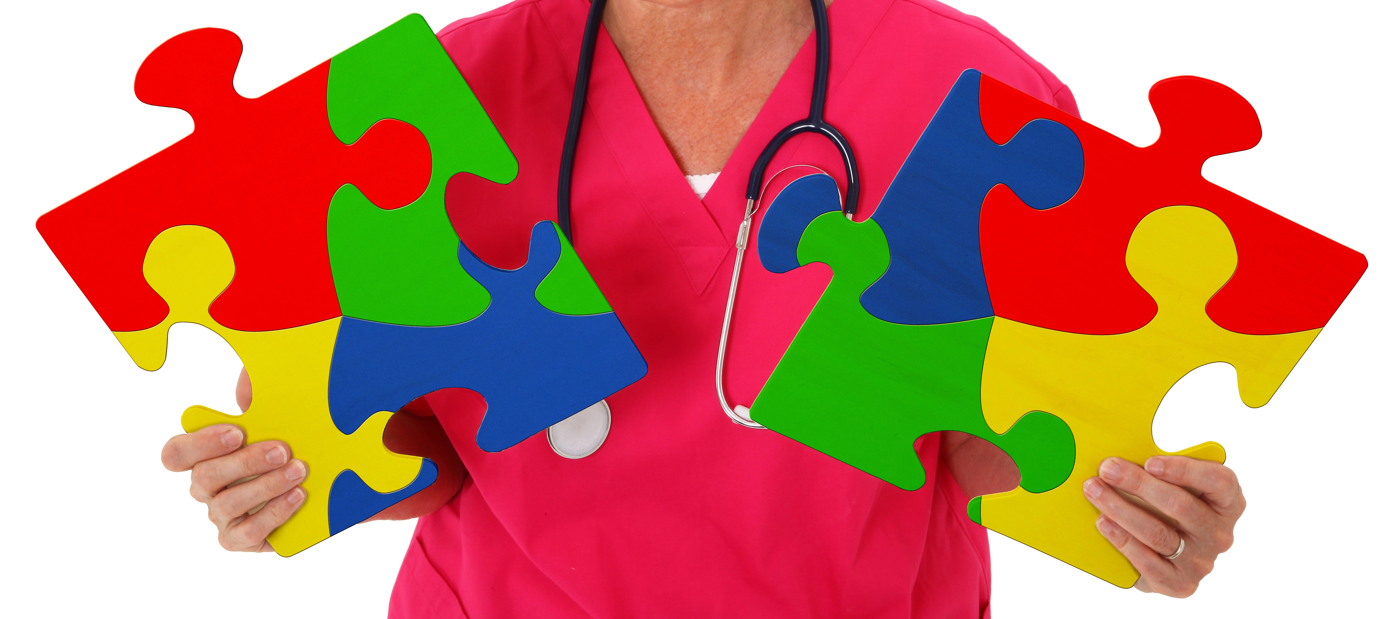 Nurse Holding Two Puzzle Pieces Representing Autism Awareness - Growing Your Baby