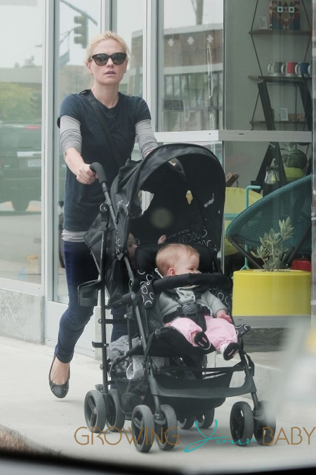 Anna Paquin pulls double duty with one of her twins in a harness and the other in a stroller while walking in Los Angeles