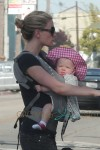 True Blood star Anna Paquin walks up and down Abbot Kinney with one of her babiess in a chest harness and the other in the stroller in Venice Beach