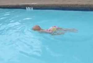 Baby Elizabeth swims the length of the pool