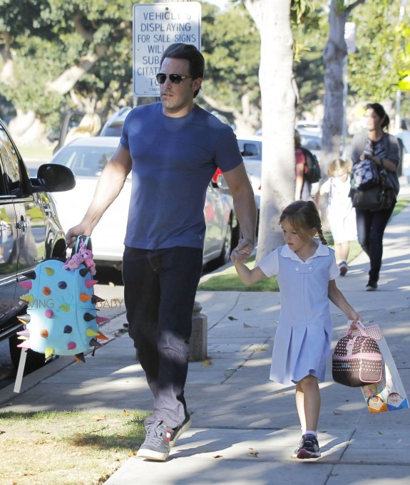 Ben Affleck carries fancy school bag of her daughter Seraphina as he picks her up from school in Los Angeles