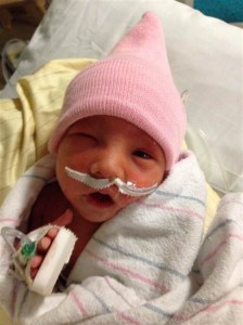 Bentley Doss, one of three identical girl triplets