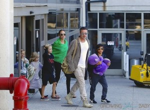 Brad Pitt and Angelina Jolie at LAX with kids Pax, Shiloh, Vivienne and Knox