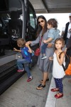 Camila Alves at the airport with kids Levi, Vida and Livingston McConaughey