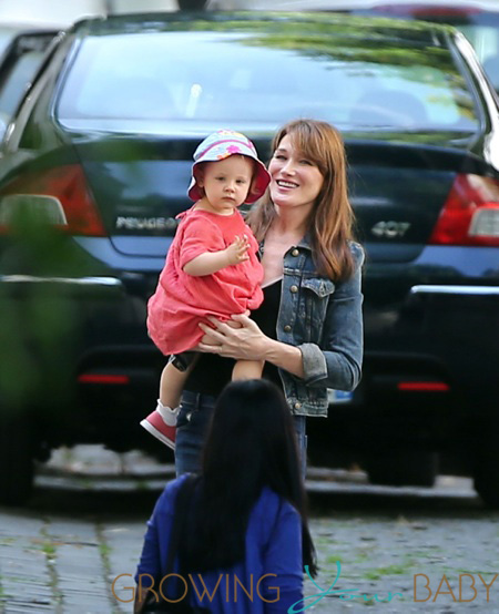 Carla Bruni-Sarkozy and Giulia arrive at home in Paris