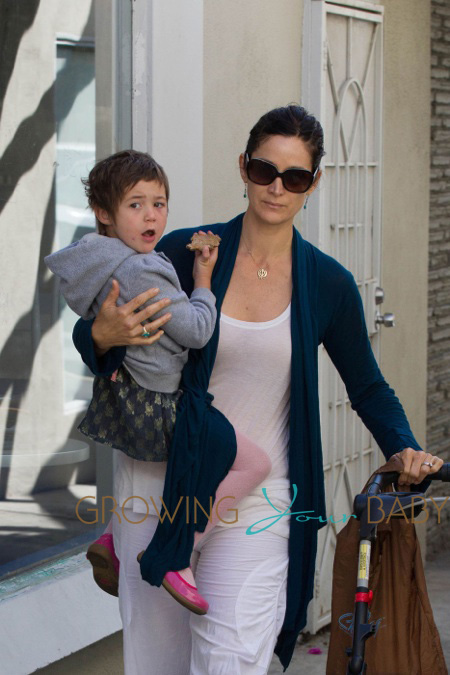 Carrie Anne Moss takes her daughter Frances Beatrice Roy to the Farmers Market in Pacific Palisades, Los Angeles