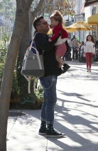 Cash Warren carries his daughter Haven