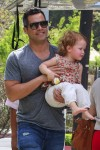 Cash Warren out at the park with daughter Haven