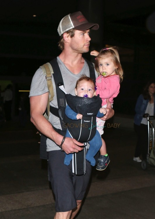 Chris Hemsworth carries his daughter India and son at LAX