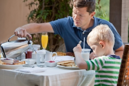 Dad and son having breakfast