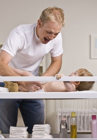 Dad changing diapers