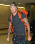 David Beckham looks casually cool when arriving at JFK airport in NYC