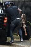 David Beckham pulls Harper on his suitcase