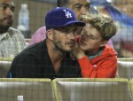 David Beckham watches the LA Dodgers play the Atlanta Braves with his boys