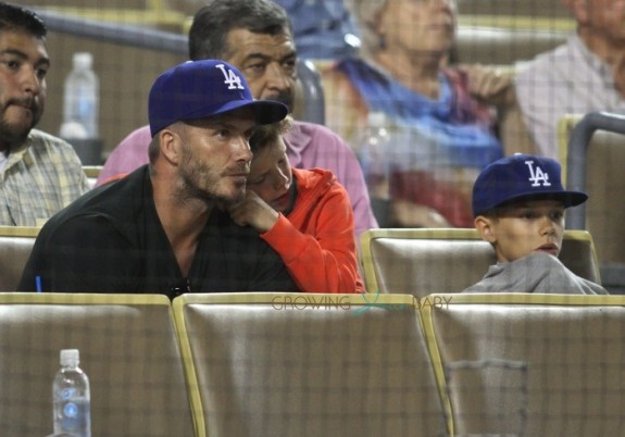 David Beckham watches the Los Angeles Dodgers play the Atlanta Braves with his boys