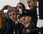 David Beckham with his family front row at NYFW14