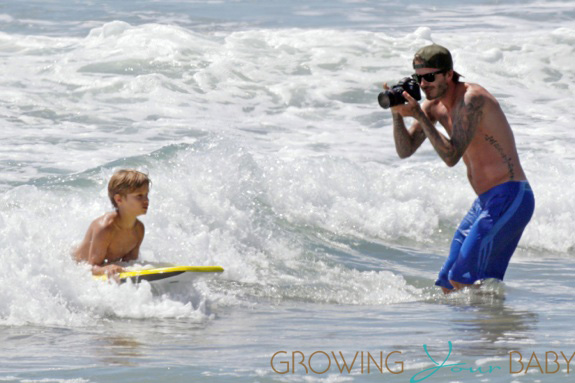 SURFS UP! David Beckham takes his sons Brooklyn, Romeo and Cruz to hit the surf and sand in Los Angeles