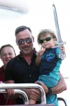 David Furnish with his son Zachary on a yacht in St