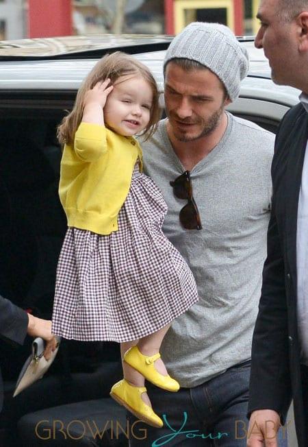 David & Victoria Beckham Take Harper Along While Shopping In Paris