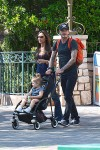 David and Victoria Beckham at Disneyland with their daughter Harper