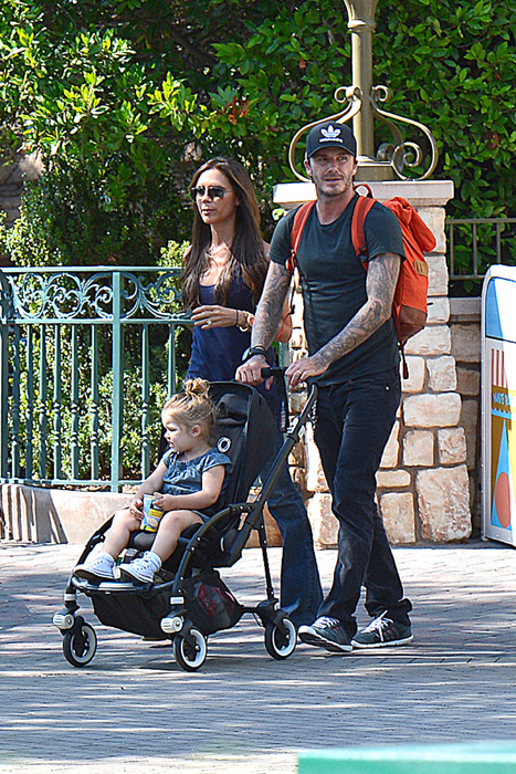 David and Victoria Beckham at Disneyland with their daughter Harper