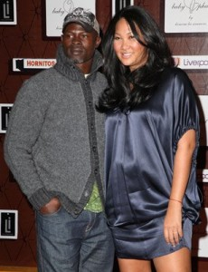 Djimon Hounsou and a pregnant Kimora Lee Simmons at clothing launch in Mexico City