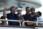 Elton John and David Furnish with their sons Elijah and Zachary Furnish-John on a yacht in St. Tropez