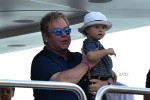 Elton John with his son Elijah on a yacht in St. Tropez