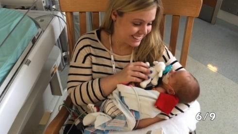 Erin Marshall holding her son Alexander