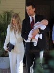 Fergie and Josh Duhamel with their son Axl at his baptism