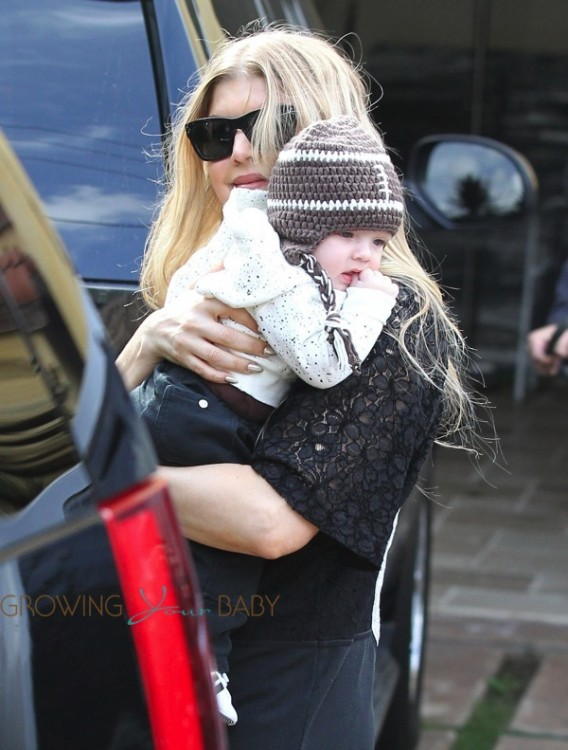 Fergie outside Super Bowl party w: son AXL