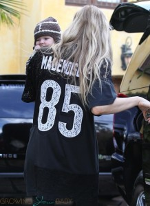 Fergie outside Super Bowl party with son AXL