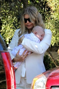Fergie with son Axl at his baptism