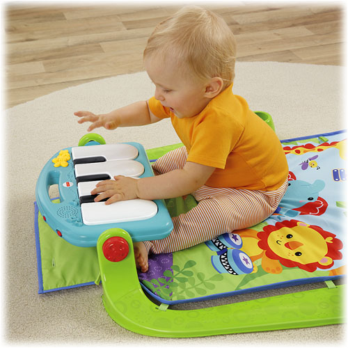 Fisher-Price Kick N Play Piano Gym - sitting at Piano