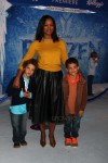 Garcelle Beauvais with sons Jax and Jaid Nilon at Disney's Frozen Premiere