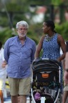 George Lucas and his wife Mellody Hobson with their daughter Everest  stroll in St. Barts