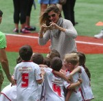 Gisele Bundchen with son John at his soccer game