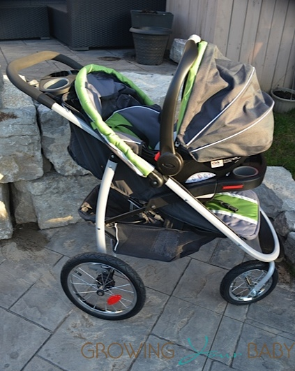 Graco FastAction Fold Jogger Click Connect Stroller with infant seat attached