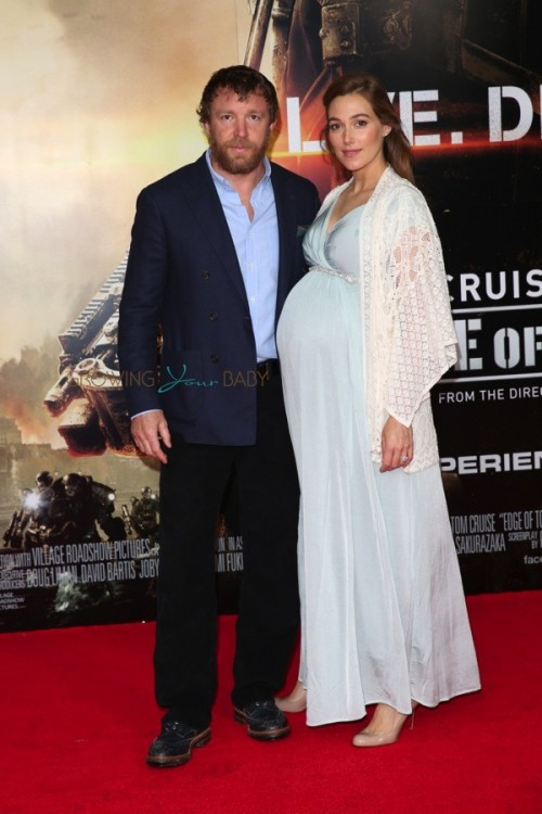 Guy Ritchie, a very pregnant Jacqui Ainsley at Edge of Tomorrow Premiere