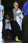 Gwen Carries her son Apollo to the car after Joel Silver's memorial day party