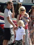 Gwen Stefani and Gavin Rossdale with baby Apollo at Zuma's graduation