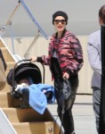Gwen Stefani boards a private plane with son Apollo