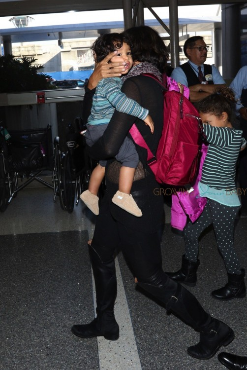 Halle Berry Makes her way through LAX with her kids Maceo and Nahla