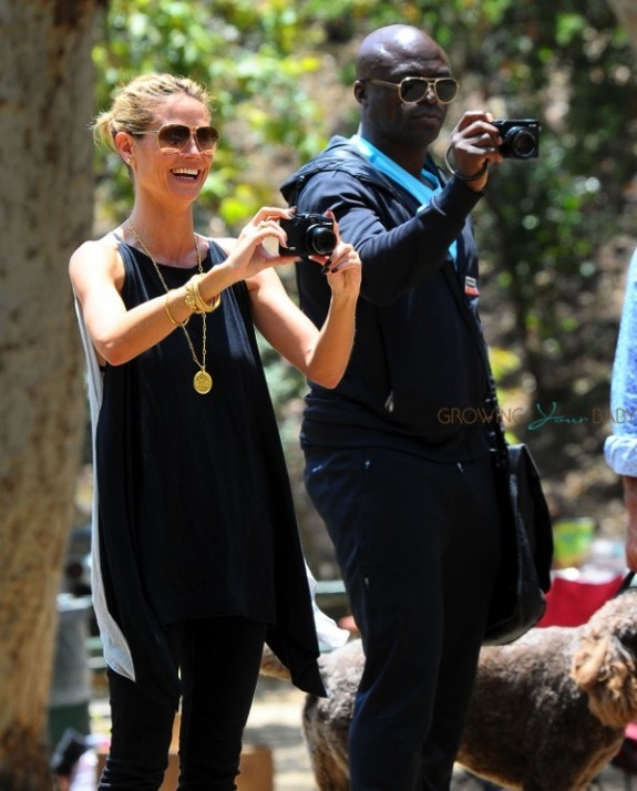 Heidi Klum and Seal take pictures of their boys at the soccer field