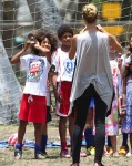 Heidi Klum takes a picture of her boys Johan and Henry at the soccer field