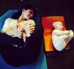 Hilaria and Carmen Baldwin practice yoga