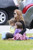 Isla Fisher attends a birthday party with daughters, Olive Cohen and Elula Lottie Miriam Cohen, at The Coldwater Park in Beverly Hills