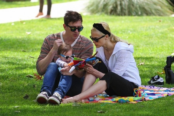 Jaime King and Kyle Newman out at the park with son James