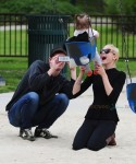 Jaime King and husband Kyle Newman with son James at the park